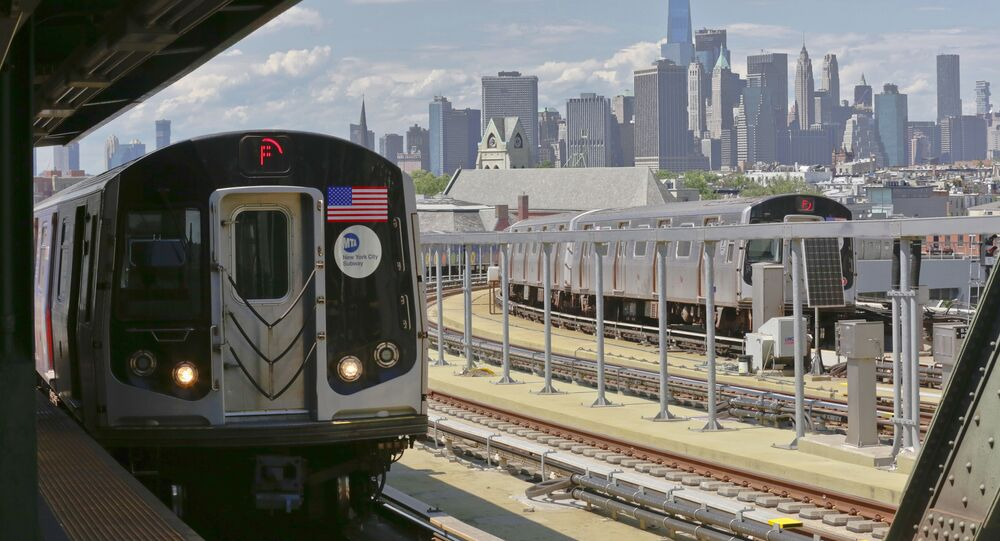 In this June 21, 2017 file photo, a subway train approaches the platform at Brooklyn's Smith Street above-ground subway station, in New York.