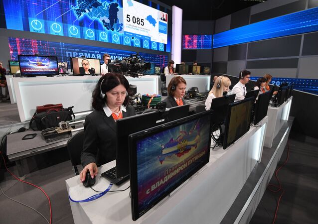 Call-center operators before the Direct Line with Russian President Vladimir Putin in Gostiny Dvor