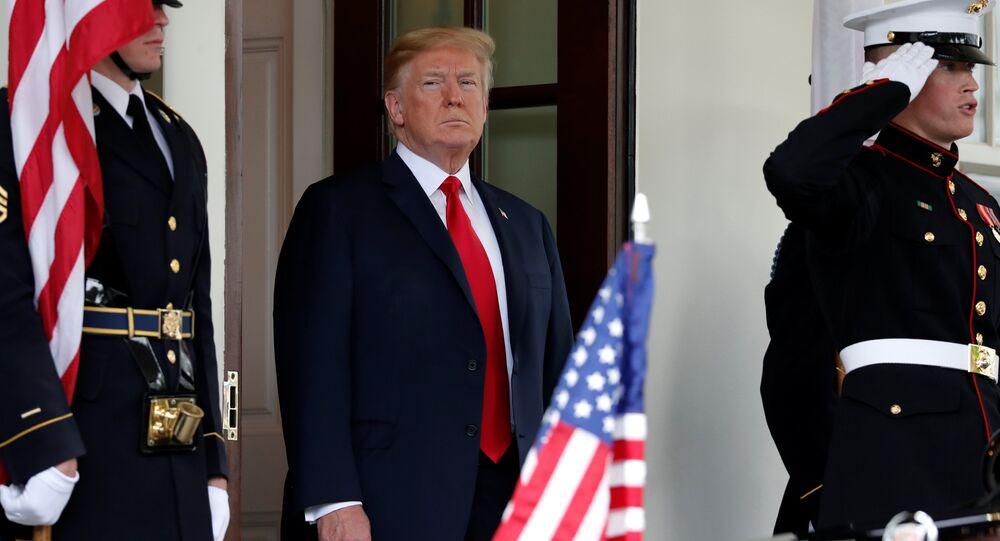U.S. President Donald Trump awaits the arrival of Japanese Prime Minister Shinzo Abe at the White House in Washington, U.S., June 7, 2018