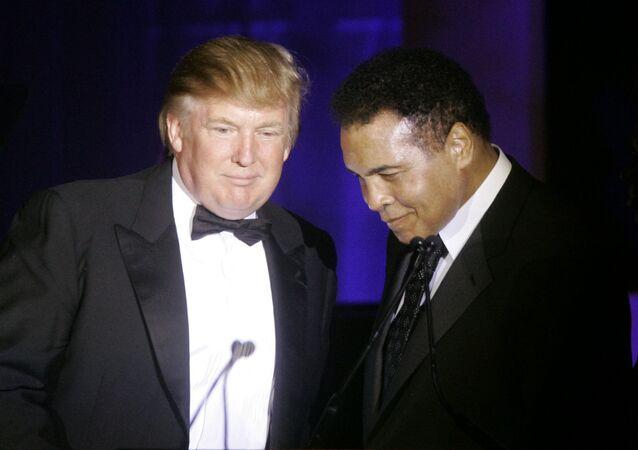 (File) Donald Trump, left, accepts his Muhammad Ali award from Ali at Muhammad Ali's Celebrity Fight Night XIII in Phoenix, Ariz., Saturday, March 24, 2007