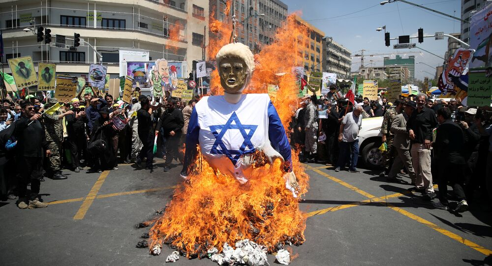 Iranians burn an effigy in the likeness of U.S. President Donald Trump during a protest marking the annual al-Quds Day (Jerusalem Day) on the last Friday of the holy month of Ramadan in Tehran, Iran June 8, 2018