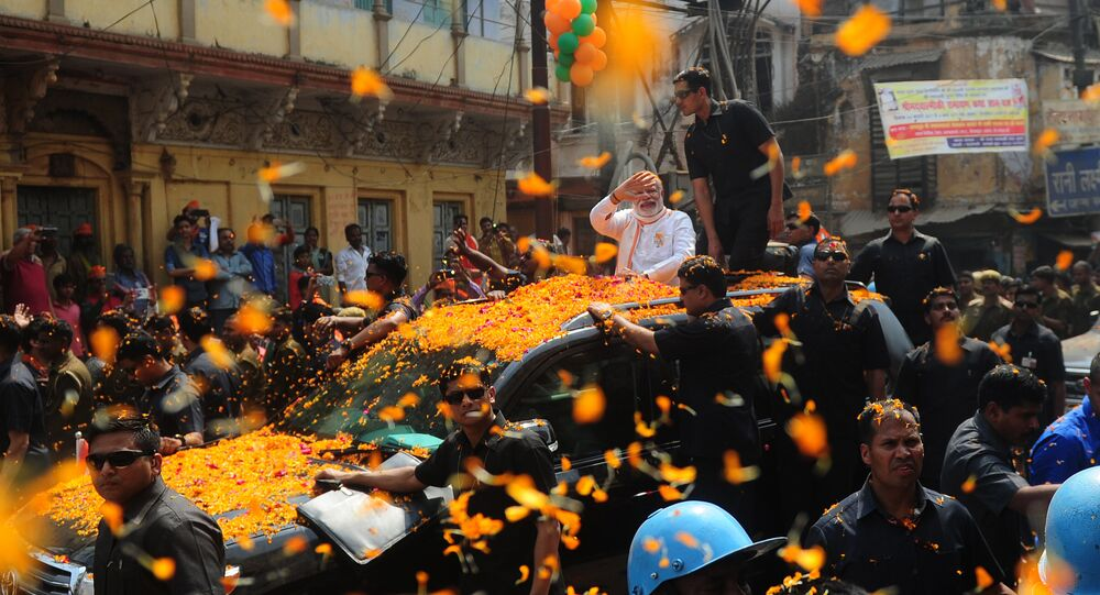 Indian Prime Minister Narendra Modi and leader of the Bharatiya Janata Party (BJP) gestures during a roadshow in support of state assembly election party candidates in Varanasi on March 4, 2017
