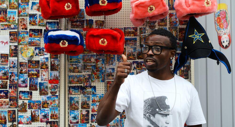 A man near a spot selling souvenirs on Moscow's oldest street, Nikolskaya