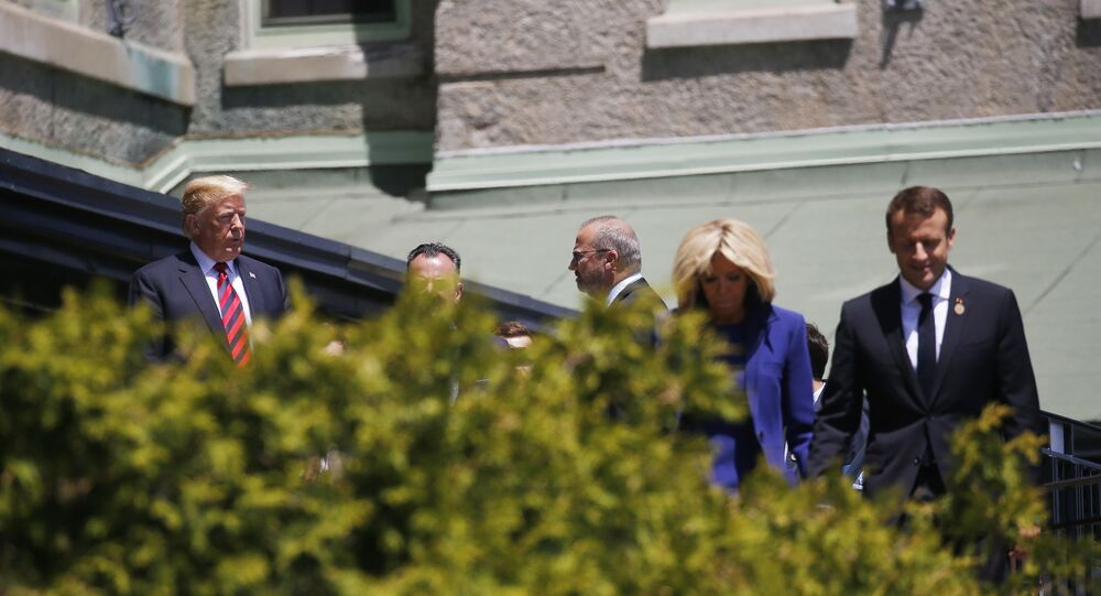 U.S. President Donald Trump looks over at France's President Macron as he arrives at the G7 Summit in Charlevoix, Canada