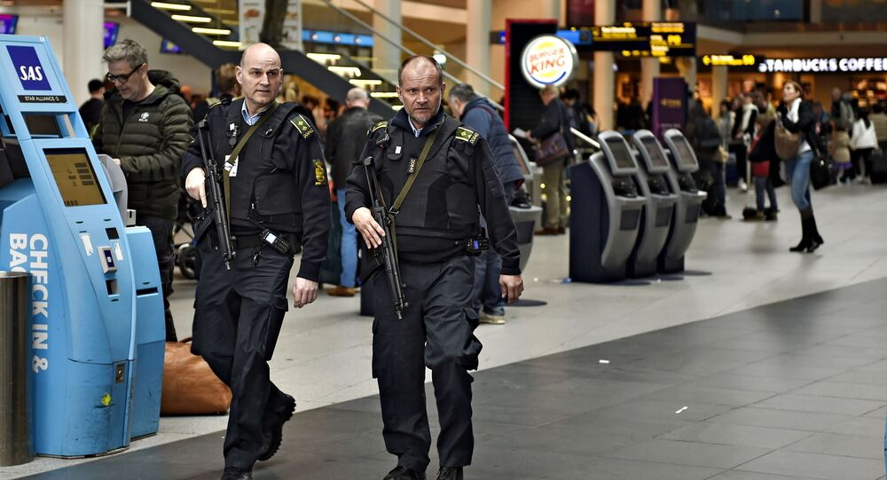 Armed police is seen on patrol as police and airport's own security personnel have increased patrols at Copenhagen Airport, Denmark March 22 2016
