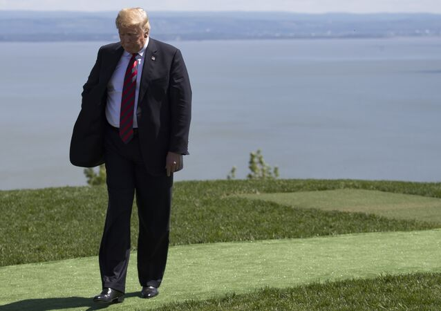 US President Donald Trump steps away after the family photo at the G7 Summit in La Malbaie, Canada, June 8, 2018.