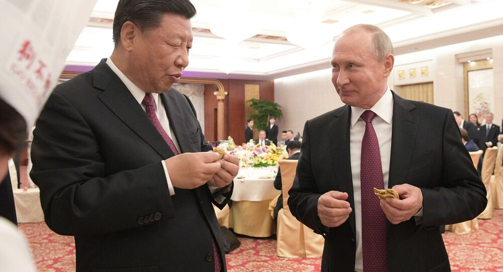 President Vladimir Putin and Chinese President Xi Jinping at a reception in Tianjin.
