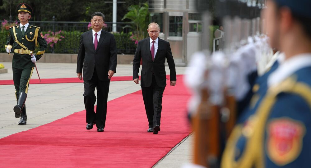 Presidents Putin and Xi during their meeting in Beijing.