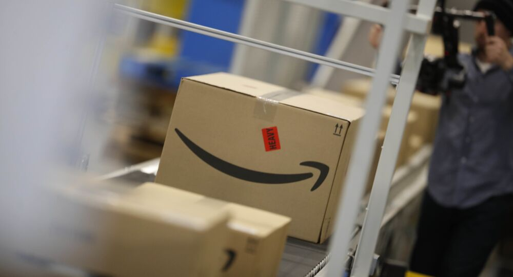 Boxes move down a conveyor belt at an Amazon fulfillment center