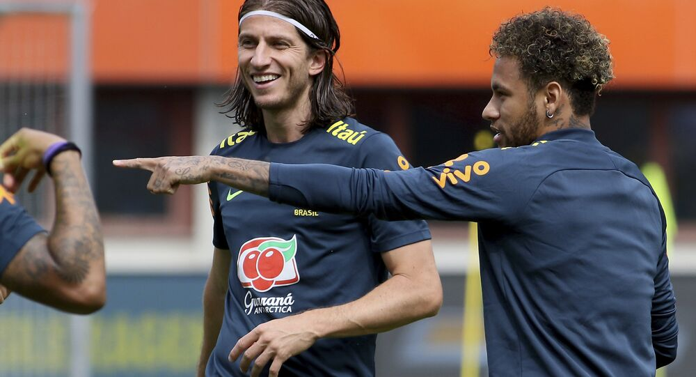 Brazil's Filipe Luis and Neymar, from left, jokes during a national soccer squad training session at the Ernst Happel Stadium in Vienna, Austria, Sturday, June 9, 2018.