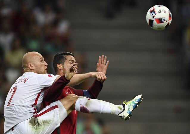 Polish footballer Michał Pazdan faces off against Portugual's Cristiano Ronaldo during the 2016 UEFA European Championship