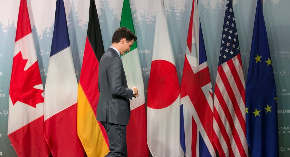 Canada's Prime Minister Justin Trudeau leaves a press conference at the G7 Summit in the Charlevoix town of La Malbaie, Quebec