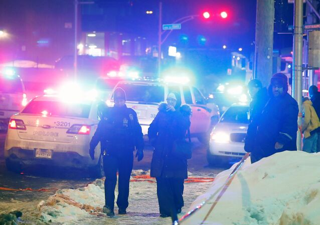 Police officers are seen near a mosque after a shooting in Quebec City, January 29, 2017