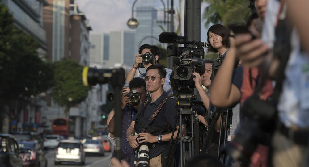 Journalists wait for North Korean leader Kim Jong Un outside the Istana, or Presidential Palace, in Singapore, Sunday, June 10, 2018, Kim met with Singapore Prime Minister Lee Hsien Loong ahead of the summit with U.S. leader Donald Trump