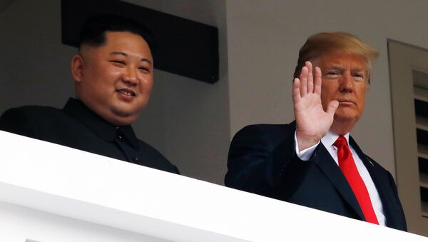 U.S. President Donald Trump and North Korean leader Kim Jong Un react at the Capella Hotel on Sentosa island in Singapore June 12, 2018. - Sputnik International