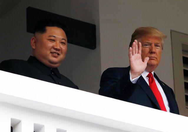 U.S. President Donald Trump and North Korean leader Kim Jong Un react at the Capella Hotel on Sentosa island in Singapore June 12, 2018.
