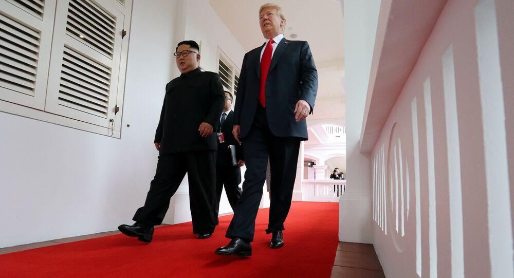 U.S. President Donald Trump walks with North Korean leader Kim Jong Un at the Capella Hotel on Sentosa island in Singapore June 12, 2018.