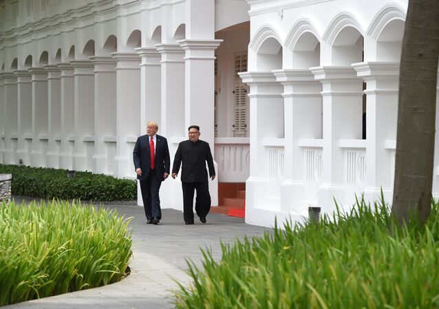 U.S. President Donald Trump and North Korean leader Kim Jong Un walk in the Capella Hotel after their working lunch, on Sentosa island in Singapore June 12, 2018