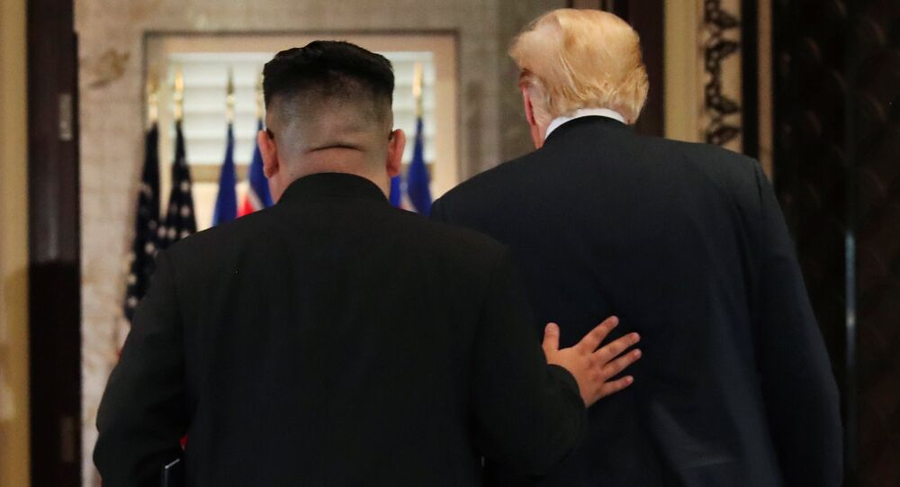U.S. President Donald Trump and North Korea's leader Kim Jong Un leave after signing documents that acknowledge the progress of the talks and pledge to keep momentum going, after their summit at the Capella Hotel on Sentosa island in Singapore June 12, 2018