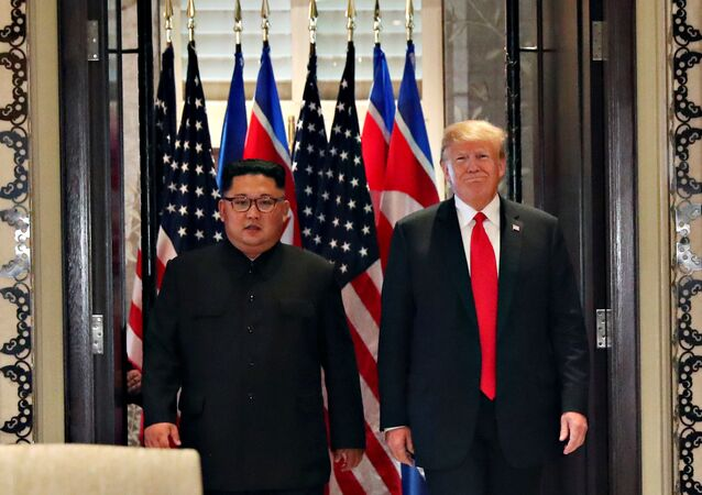 U.S. President Donald Trump and North Korea's leader Kim Jong Un arrive to sign documents that acknowledge the progress of the talks and pledge to keep momentum going, after their summit at the Capella Hotel on Sentosa island in Singapore June 12, 2018