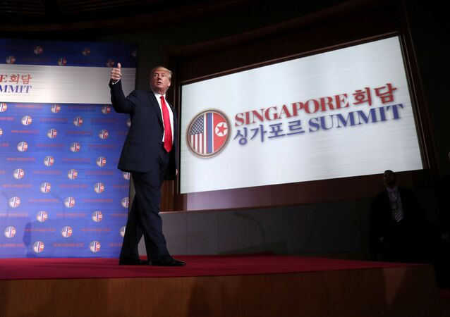 U.S. President Donald Trump gestures after a news conference after his meeting with North Korean leader Kim Jong Un at the Capella Hotel on Sentosa island in Singapore June 12, 2018