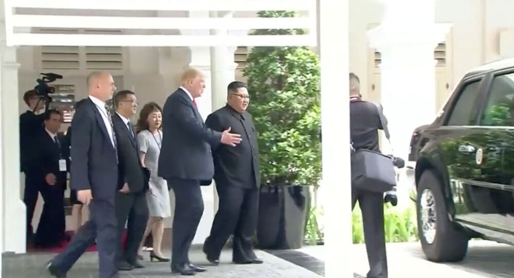 U.S. President Donald Trump shows North Korean leader Kim Jong Un his car, nicknamed The Beast, during their walk around Capella hotel after a working lunch at a summit in Singapore, June 12, 2018, in this still image taken from video