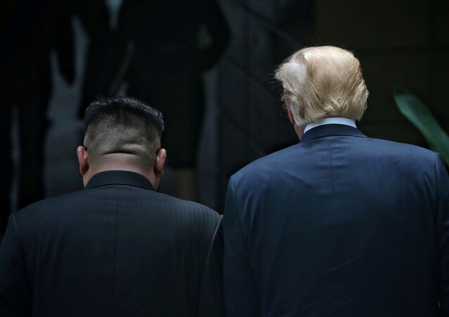 U.S. President Donald Trump walks with North Korean leader Kim Jong Un at the Capella Hotel on Sentosa island in Singapore June 12, 2018