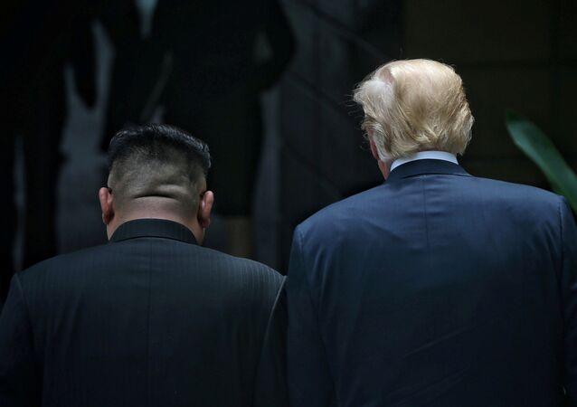 U.S. President Donald Trump walks with North Korean leader Kim Jong Un at the Capella Hotel on Sentosa island in Singapore June 12, 2018