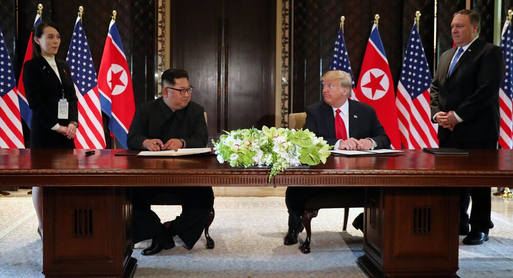 U.S. President Donald Trump and North Korea's leader Kim Jong Un look at each others before signing documents that acknowledge the progress of the talks and pledge to keep momentum going, after their summit at the Capella Hotel on Sentosa island in Singapore June 12, 2018