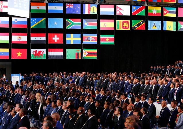 Participants of the 68th FIFA Congress observe a minute of silence in memory of delegates, who recently passed away, in Moscow, Russia June 13, 2018.