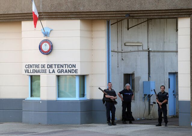 In this file photo taken on June 14, 2017 police stand at the entrance of the prison of Villenauxe-la-Grande, eastern France, where a prison guard was taken hostage by an inmate