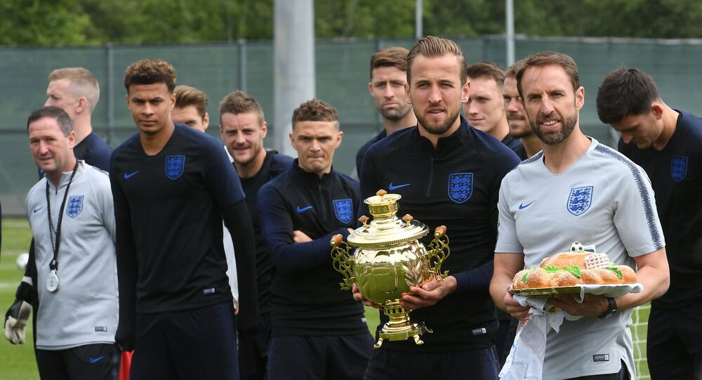 Members of England's national soccer team carry traditional Russian souvenirs before the training session ahead of the World Cup 2018 in Saint Petersburg, Russia, on June 13, 2018