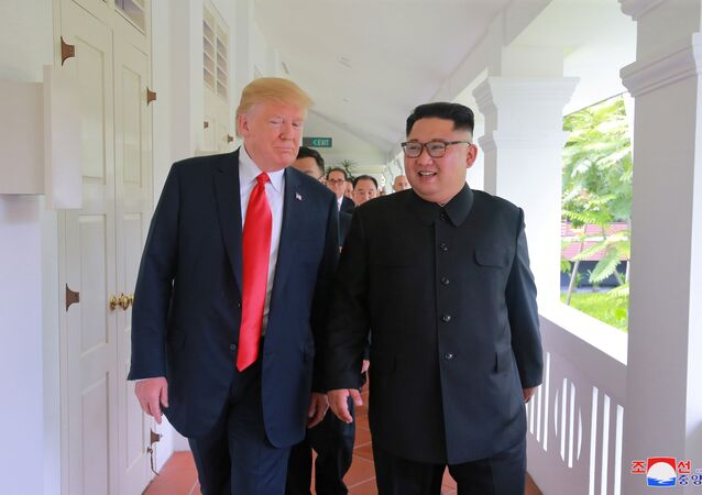 U.S. President Donald Trump walks with North Korean leader Kim Jong Un at the Capella Hotel on Sentosa island in Singapore in this picture released on June 12, 2018 by North Korea's Korean Central News Agency