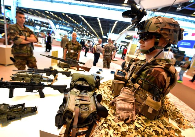 French military stand next to French military equipment, presented on June 11, 2018 during the the Eurosatory defence and security international exhibition in Villepinte, near Paris
