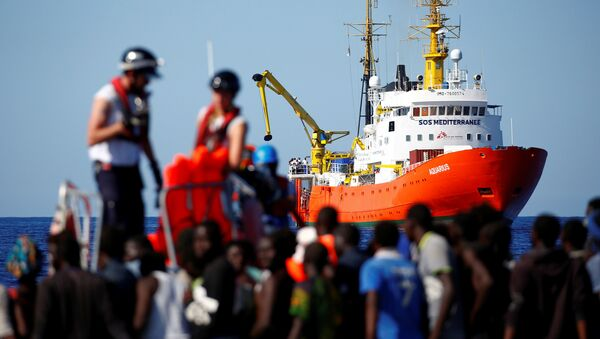 The MV Aquarius rescue ship is seen as migrants on are rescued by the SOS Mediterranee organisation during a search and rescue (SAR) operation in the Mediterranean Sea, off the Libyan Coast, September 14, 2017 - Sputnik International