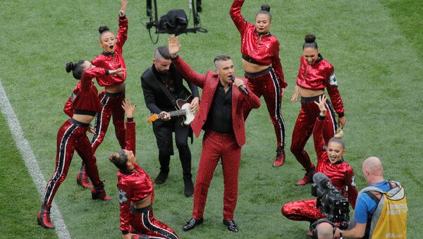 Soccer Football - World Cup - Opening Ceremony - Luzhniki Stadium, Moscow, Russia - June 14, 2018 Robbie Williams performs during the opening ceremony - Sputnik International