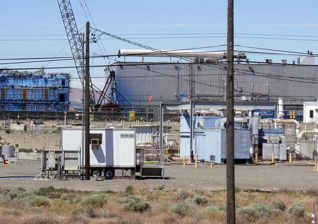 This May 13, 2017, photo shows a portion of the Plutonium Finishing Plant on the Hanford Nuclear Reservation near Richland, Wash. Officials say dozens of workers demolishing the 1940s-era plutonium processing plant there have ingested or inhaled radioactive particles in the past year, prompting a halt to the demolition of the plant until a safe plan can be developed.