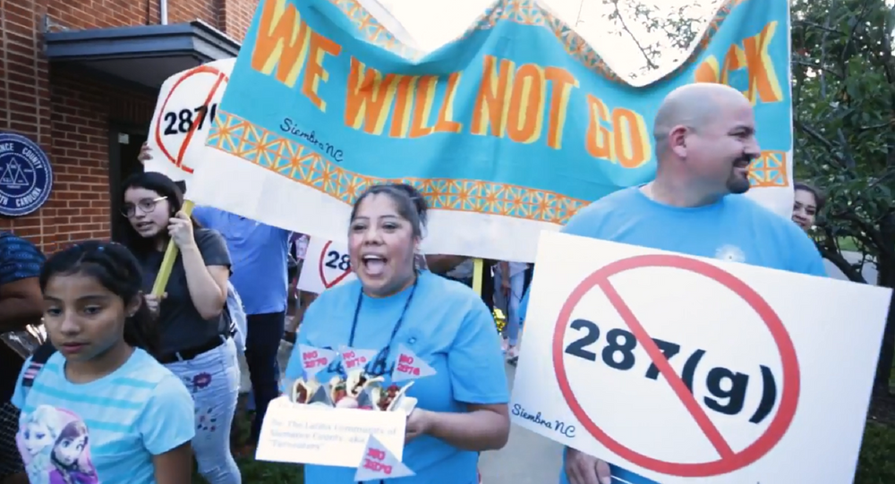 Latino residents in Alamance County, North Carolina protest sheriff's push to renew a partnership with Immigration and Customs Enforcement after he was investigated by the Department of Justice for bias.