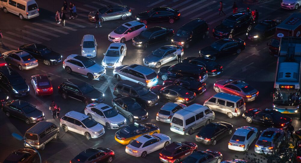 This picture taken on April 16, 2018 shows a traffic jam at a crossroad in the city centre of Beijing