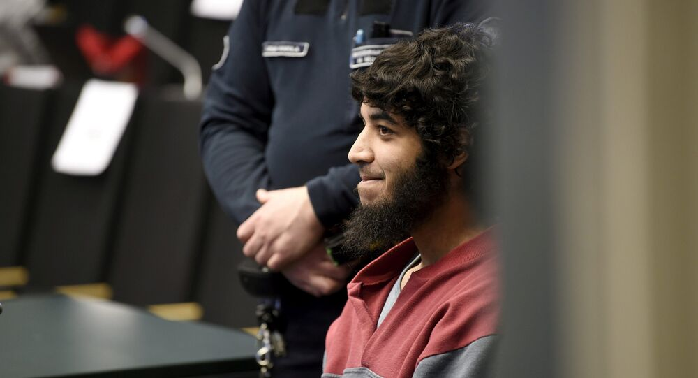 Abderrahman Bouanane, who is accused of two murders and eight murder attempts, attends his trial in Turku, Finland April 9, 2018