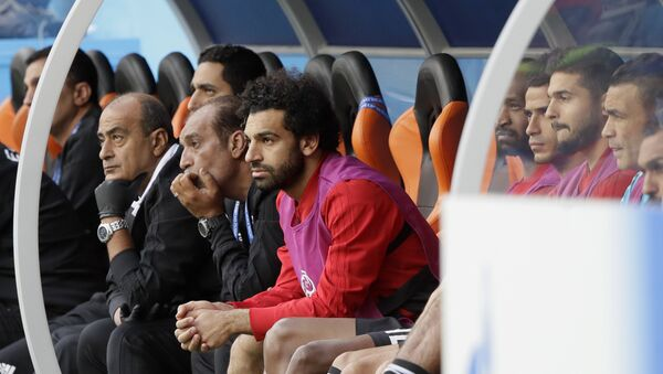 Egypt's Mohamed Salah, center, watches his team during the group A match between Egypt and Uruguay at the 2018 soccer World Cup in the Yekaterinburg Arena in Yekaterinburg, Russia, Friday, June 15, 2018 - Sputnik International