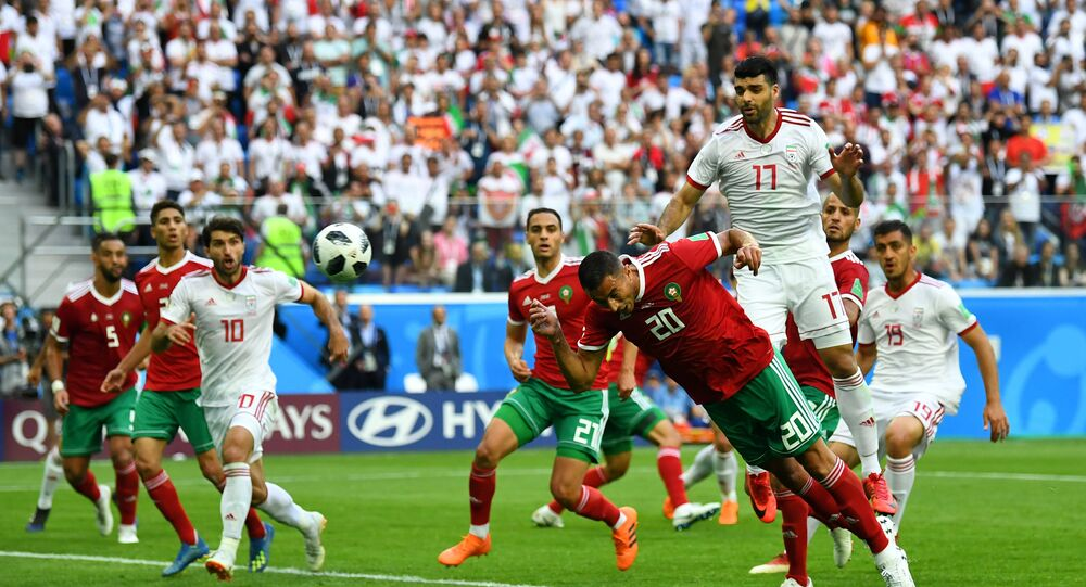Soccer Football - World Cup - Group B - Morocco vs Iran - Saint Petersburg Stadium, Saint Petersburg, Russia - June 15, 2018 Morocco's Aziz Bouhaddouz scores an own goal for Iran's first goal