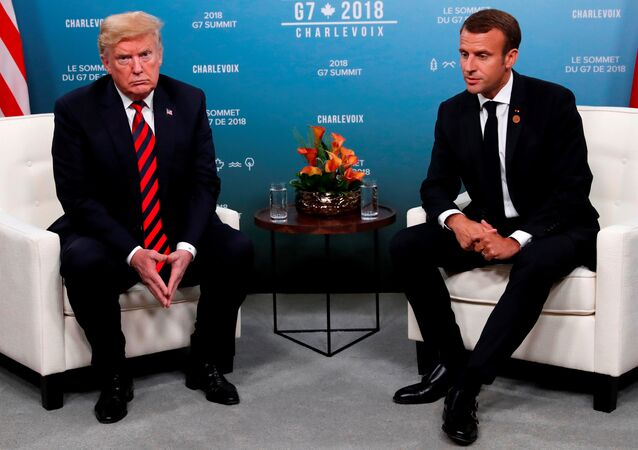 U.S. President Donald Trump and France's President Emmanuel Macron sit side by side during a bilateral meeting at the G7 Summit in in Charlevoix, Quebec, Canada, June 8, 2018.