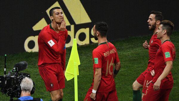 Soccer Football - World Cup - Group B - Portugal vs Spain - Fisht Stadium, Sochi, Russia - June 15, 2018 Portugal's Cristiano Ronaldo celebrates scoring their first goal - Sputnik International