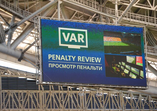 A screen installed at the Kazan Arena shows penalty video review moment during the World Cup Group C soccer match between France and Australia in Kazan, Russia, June 16, 2018