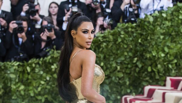 Kim Kardashian attends The Metropolitan Museum of Art's Costume Institute benefit gala celebrating the opening of the Heavenly Bodies: Fashion and the Catholic Imagination exhibition on Monday, May 7, 2018, in New York - Sputnik International
