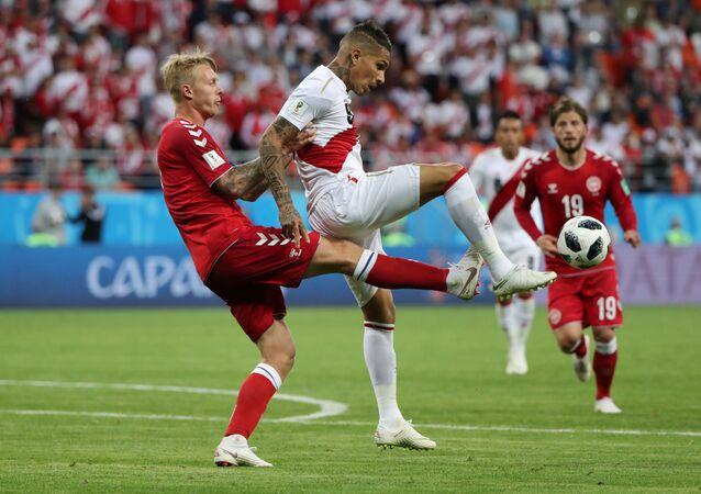 Denmark's Simon Kjaer in action with Peru's Paolo Guerrero, Peru vs Denmark - Mordovia Arena, Saransk, Russia - June 16, 2018