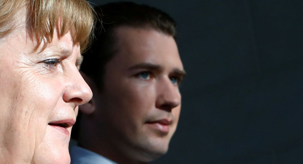 German Chancellor Angela Merkel and Austrian Chancellor Sebastian Kurz arrive at a news conference in the chancellery in Berlin