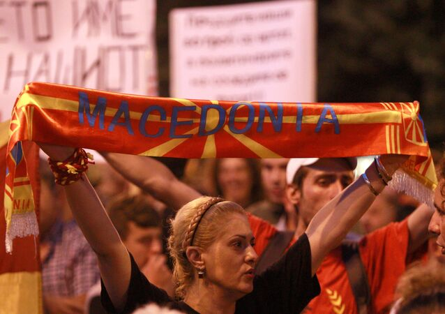 Protestors shout slogans against the change of the country's constitutional name in front of the Parliament building in Skopje, Macedonia June 13, 2018.