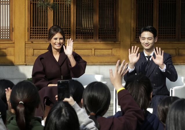 U.S. first lady Melania Trump and Choi Min-ho, a member of South Korean boy band Shinee, wave to South Korean middles school students during Girls Play 2! Initiative, an Olympic public diplomacy outreach campaign, at the U.S. Ambassador's Residence in Seoul, South Korea, Tuesday, Nov. 7, 2017